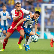 BARCELONA, SPAIN - August 18:  Wu Lei #7 of Espanyol defended by Joan Jordan #24 of Sevilla during the Espanyol V  Sevilla FC, La Liga regular season match at RCDE Stadium on August 18th 2019 in Barcelona, Spain. (Photo by Tim Clayton/Corbis via Getty Images)