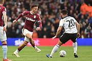 Aston Villa midfielder Jack Grealish (10) looks to release the ball during the EFL Sky Bet Championship match between Aston Villa and Derby County at Villa Park, Birmingham, England on 2 March 2019.