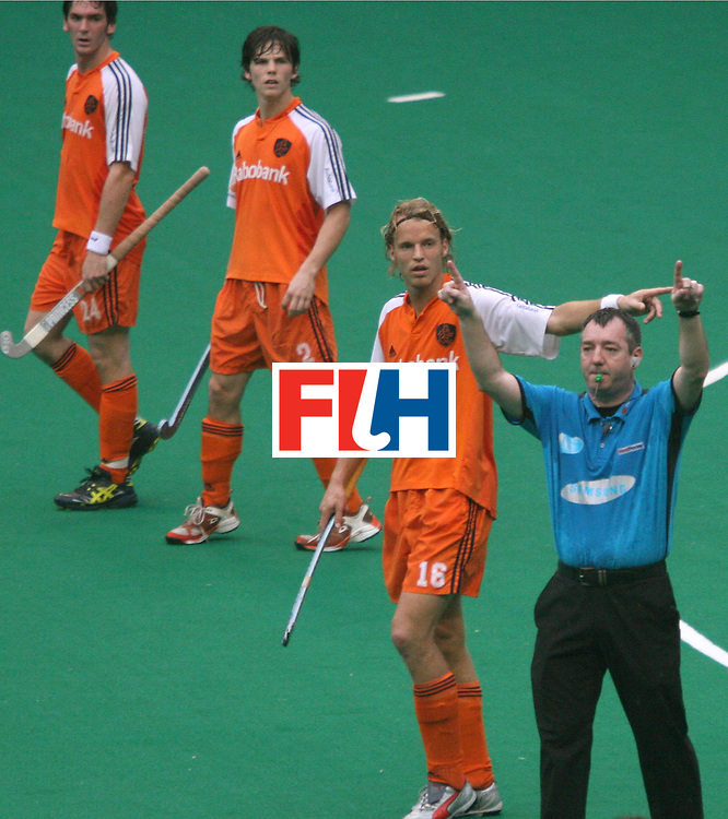 Kuala Lumpur : Umpire Curran Ged requesting for TV Umpire decision in the match between Netherlands and Australia in  the Samsung Hockey Men Champions Trophy  at the National Stadium, Bukit Jalil, Malaysia on 06 Dec 2007. This match is the 500th match of the Champion trophy history.<br /> Australia drew with Netherlands.<br />  Photo:GNN/Vino John