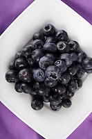 Close-up of blueberries on white plate