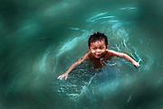 A boy swimming near Don Khon in Si Pandon, Laos.