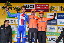 November 25, 2017 - Zeven, GERMANY - Czech Thomas Kopecky, Dutch Pim Ronhaar and Dutch Mees Hendrikx celebrate on the podium after the men junior race of the World Cup cyclocross in Zeven, Germany, the fifth race of the UCI Cyclocross World Cup championship, Saturday 25 November 2017. BELGA PHOTO LUC CLAESSEN (Credit Image: © Luc Claessen/Belga via ZUMA Press)