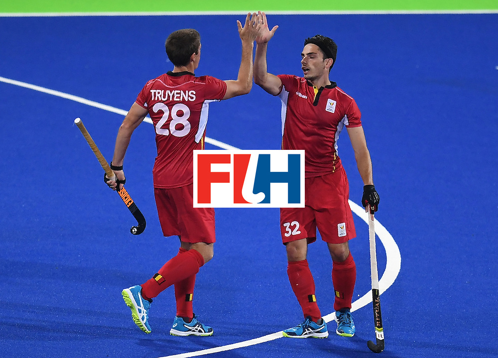 Belgium's Tanguy Cosyns (L) celebrates scoring a goal with teammate Belgium's Jerome Truyens during the men's field hockey Belgium vs Australia match of the Rio 2016 Olympics Games at the Olympic Hockey Centre in Rio de Janeiro on August, 9 2016. / AFP / MANAN VATSYAYANA        (Photo credit should read MANAN VATSYAYANA/AFP/Getty Images)
