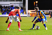 Jordan Clark of Shrewsbury Town takes on James Maddison of Coventry City FC during the Sky Bet League 1 match between Shrewsbury Town and Coventry City at Greenhous Meadow, Shrewsbury, England on 8 March 2016. Photo by Mike Sheridan.