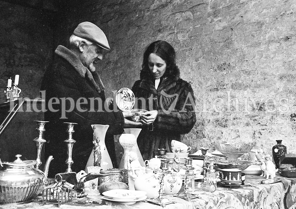 William Costello with a customer interested in antiques at the Dandelion Market, December 4 1971.<br />