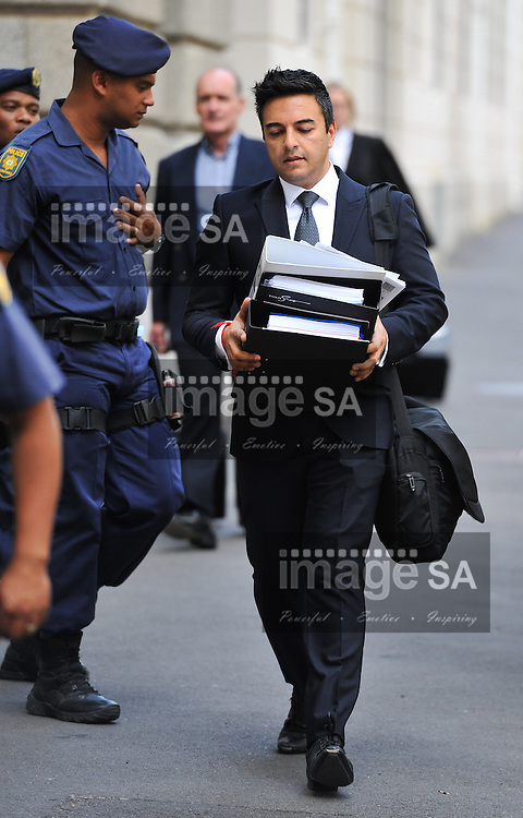 CAPE TOWN, SOUTH AFRICA - Monday 13 October 2014,  Preyen Dewani, brother of Shrien Dewani, arrives at court carrying court documents during Day 4 of the Shrien Dewani trial at the Cape High Court before Judge Jeanette Traverso. Dewani is caused of hiring hit men to murder his wife, Anni. Anni Ninna Dewani (n&eacute;e Hindocha; 12 March 1982 &ndash; 13 November 2010) was a Swedish woman who, while on her honeymoon in South Africa, was kidnapped and then murdered in Gugulethu township near Cape Town on 13 November 2010 (wikipedia).<br /> Photo by Roger Sedres