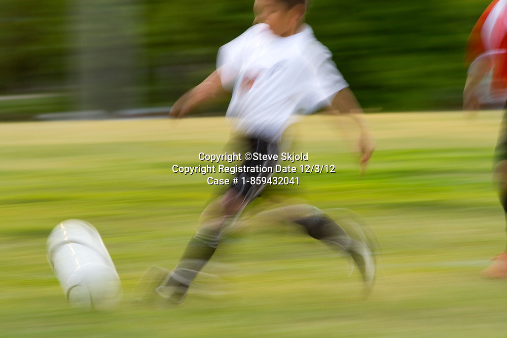 Blurred soccer player running with ball demonstrating the speed of the game. St Paul Minnesota MN USA
