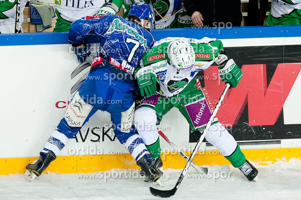 Domen Vedlin (HDD Tilia Olimpija, #7) and Adam Naglich (KHL Medvescak Zagreb, #7) during ice-hockey match between KHL Medvescak Zagreb and HDD Tilia Olimpija in 43rd Round of EBEL league, on Januar 17, 2012 at Arena Zagreb, Zagreb, Croatia. (Photo By Matic Klansek Velej / Sportida)