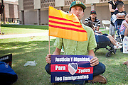 "June 13 - PHOENIX, AZ: BAO NGUYEN, from Garden Grove, CA, and an immigrant from Vietnam, at an immigrants' rally and vigil in Phoenix Sunday. About 40 immigrants' rights activists from Anaheim, California, joined Phoenix area activists at the Arizona State Capitol Sunday for a prayer vigil and rally against SB 1070, the Arizona law that gives local law enforcement agencies the power to ask to see proof of immigration status in the course of a ""lawful contact"" and when ""practicable."" Immigrants' rights and civil rights activist say the bill will lead to racial profile. Proponents of the bill say it is the toughest local anti-immigration bill in the country and merely brings state law into line with federal immigration law.  The law, which was signed by the Arizona Governor in April, goes into effect on July 29, 2010.   Photo by Jack Kurtz"