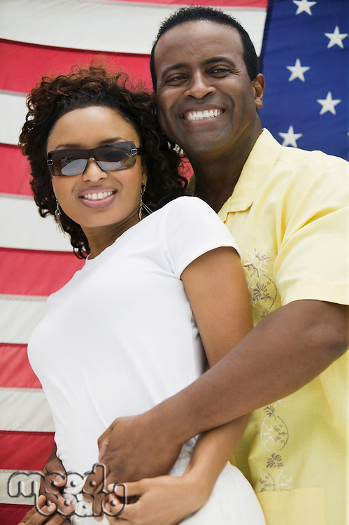 Couple in Front of American Flag