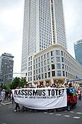 Frankfurt am Main | 05 July 2014<br /> <br /> Am Samstag (05.07.2014) demonstrierten in Frankfurt am Main etwa 250 Menschen aus der linksradikalen Szene gegen die deutsche Fl&uuml;chtlingspolitik, gegen Abschiebungen und f&uuml;r das Bleiberecht gefl&uuml;chteter Menschen in Deutschland und anderswo.<br /> Hier: Die Demo vor dem Opernturm, Transparent &quot;Rassismus t&ouml;tet&quot;.<br /> <br /> [Foto honorarpflichtig, kein Model Release]<br /> <br /> &copy;peter-juelich.com