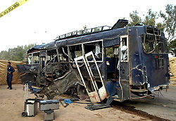 61056910<br /> The wreckage of a destroyed police bus is seen at the blast site in southern Pakistani port city of Karachi, Feb. 13, 2014. At least 11 policemen were killed and 47 others injured when a suicide bomber rammed his explosive-laden car into a police bus in Karachi Thursday morning, police said, Thursday, 13th February 2014. Picture by  imago / i-Images<br /> UK ONLY