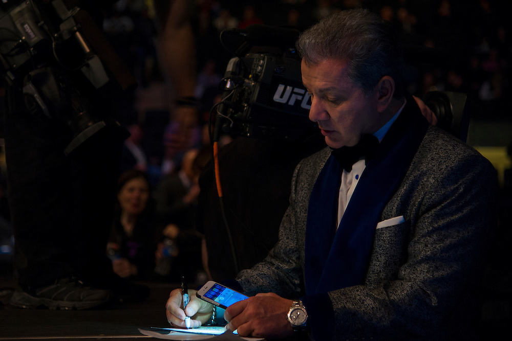 Bruce Buffer preps for the first fight UFC 205 at Madison Square Garden in New York, New York on November 12, 2016.  (Cooper Neill for The Players Tribune)