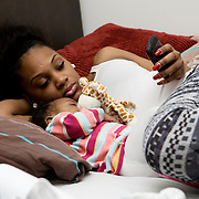 London, UK, December 19th 2001. .Teenage Parents Service at the Stockwell YMCA charity in Lambeth, South London..Chantal, Jamaican, 18 years old, with her daughter Nevaeh, 4 months..The UK remains the country with the highest teenage pregnancy rate in Europe.