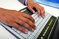 Close up of Indian mans hands typing on laptop