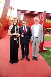 Left to right, JULIA PEYTON-JONES, Dr Ralf Speth CEO of Jaguar and HANS ULRICH OBRIST at the annual Serpentine Gallery Summer party this year sponsored by Jaguar held at the Serpentine Gallery, Kensington Gardens, London on 8th July 2010.  2010 marks the 40th anniversary of the Serpentine Gallery and the 10th Pavilion.