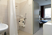 shower and bedroom in a independent living house for the elderly