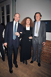 Left to right, RALPH FIENNES, NICOLE FARHI and SIR DAVID HARE at a dinner hosted by Nicole Farhi at 16 Fouberts Place, London W1 on 9th February 2009.