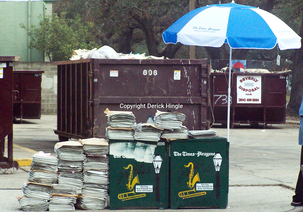 Newspapers from the Times Picayune are sold on a street corner off St. Charles Avenue in New Orleans, Louisiana as many businesses remained closed in the aftermath of Hurricane Katrina which made landfall in the small city of Buras, Louisiana in Plaquemines Parish on August 29, 2005. ..(Mandatory Credit: Photo by Derick E. Hingle)