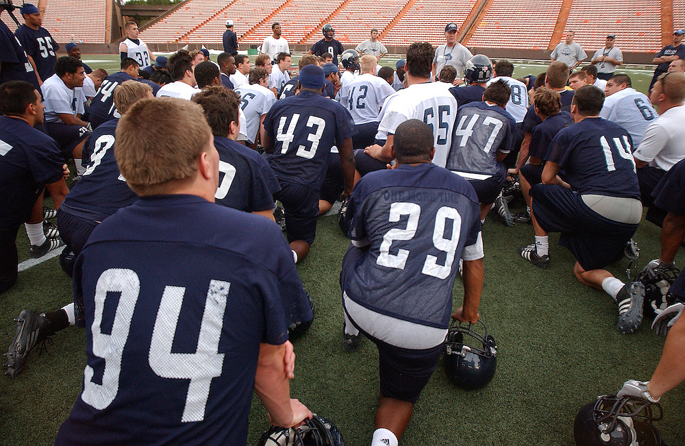 Nevada head coach Chris Ault speaks with the players following practice at Aloha Stadium in Hawaii, Friday evening, Dec. 23, 2005, the night before Nevada plays the University of Central Florida in the Sheraton Hawai'i Bowl in Honolulu.<br />