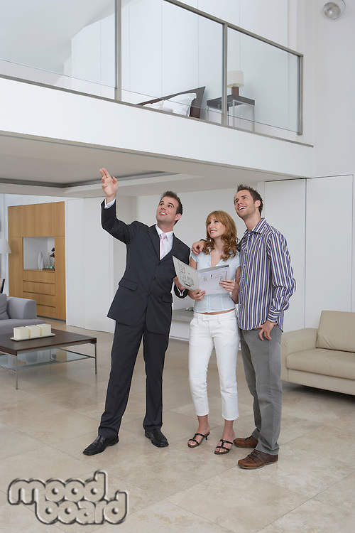 Real estate agent showing couple new home