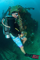 "A Diver has a ""seat"" on a World World II shipwreck.<br /> <br /> Shot in Indonesia"