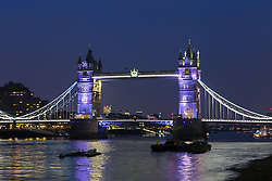 © Licensed to London News Pictures. 23/03/2016. London, UK. Tower Bridge is illuminated in PURPLE, which is not one of the colours of the Belgian tricolor flag this evening, during an illumination to pay a tribute to victims of the Belgium terrorist attacks which took place yesterday. Landmarks across London are paying tribute this evening. Photo credit : Vickie Flores/LNP