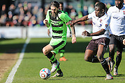 Forest Green's Rob Sinclair under pressure from Bromley's Ali Fuseini during the Vanarama National League match between Bromley FC and Forest Green Rovers at Hayes Lane, Bromley, United Kingdom on 28 March 2016. Photo by Shane Healey.