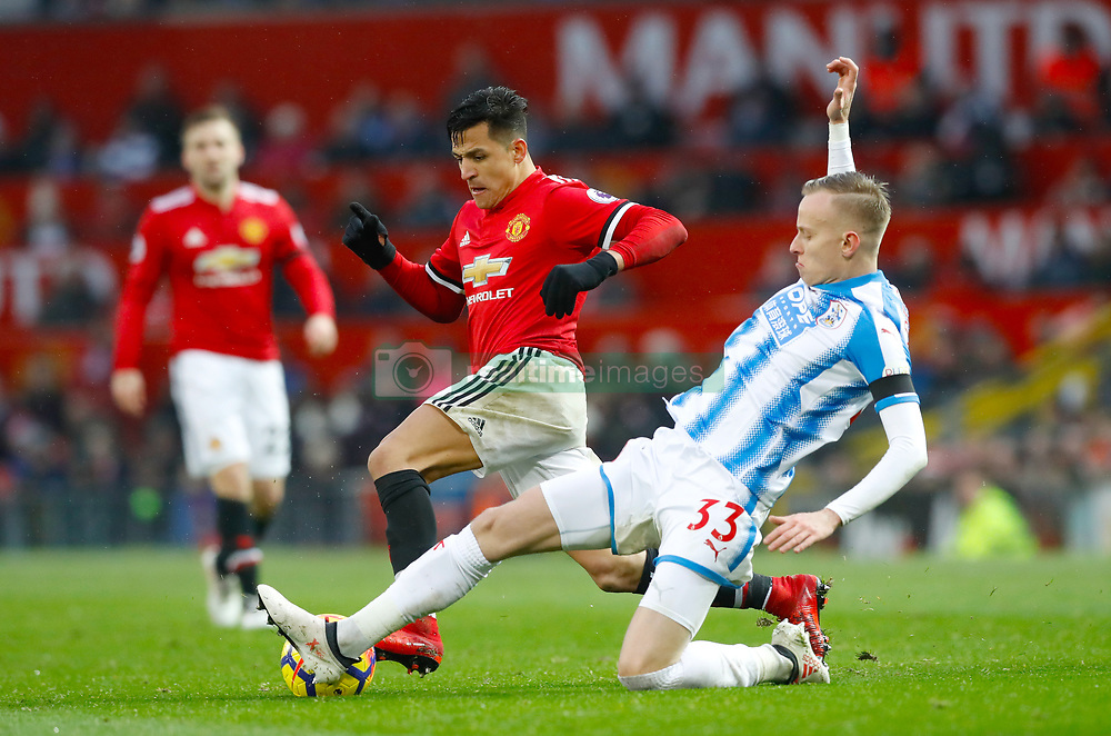 "Manchester United's Alexis Sanchez and Huddersfield Town's Florent Hadergjonaj battle for the ball during the Premier League match at Old Trafford, Manchester. PRESS ASSOCIATION Photo. Picture date: Saturday February 3, 2018. See PA story SOCCER Man Utd. Photo credit should read: Martin Rickett/PA Wire. RESTRICTIONS: EDITORIAL USE ONLY No use with unauthorised audio, video, data, fixture lists, club/league logos or ""live"" services. Online in-match use limited to 75 images, no video emulation. No use in betting, games or single club/league/player publications."