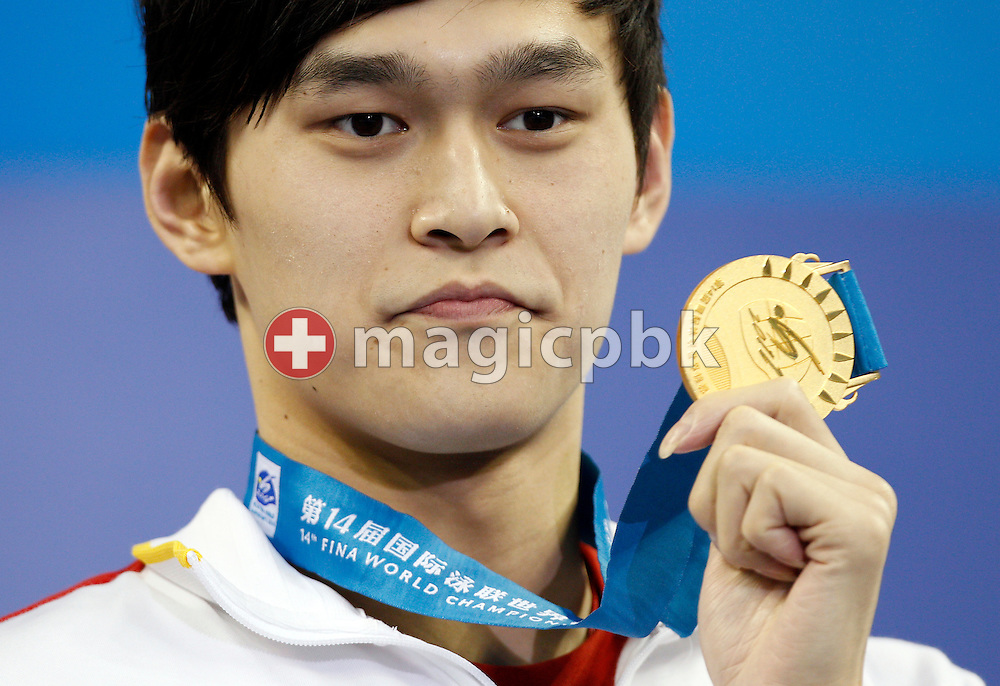 Yang SUN of China poses with his gold medal during the award ceremony for the men's 800m Freestyle Final during the 14th FINA World Aquatics Championships at the Oriental Sports Center in Shanghai, China, Wednesday, July 27, 2011. (Photo by Patrick B. Kraemer / MAGICPBK)