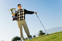 Young Man Holding Golf Trophy