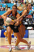Irene Van Dyk holds onto the ball for the Magic during action from the Major Semi Final of the ANZ Netball Championship played between the Firebirds and the Magic at the Gold Coast Convention and Exhibition Centre on Monday 9th May 2011