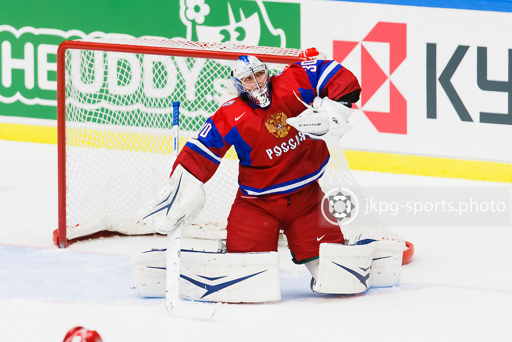 140104 Ishockey, JVM, Semifinal,  Sverige - Ryssland<br /> Icehockey, Junior World Cup, SF, Sweden - Russia.<br /> Andrei Vasilevski, (RUS) makes a save. R&auml;ddar pucken.<br /> single action.<br /> Endast f&ouml;r redaktionellt bruk.<br /> Editorial use only.<br /> &copy; Daniel Malmberg/Jkpg sports photo