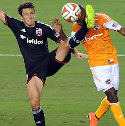 Houston Dynamo defender DaMarcus Beasley, right, is kicked in the face by D.C. United midfielder Lewis Neal during the second half of an MLS soccer game, Sunday, August 3, 2014, at BBVA Compass Stadium in Houston. (Photo: Eric Christian Smith/For the Chronicle)