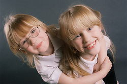 Portrait of two young sisters hugging,