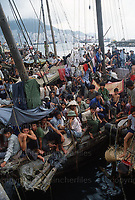 Thousands of Vietnamese refugees known as the 'boat people' seen cramped in ships moored off Hong Kong Harbour where they were kept isolated and under guard. Photograph by Terry Fincher.June 1979