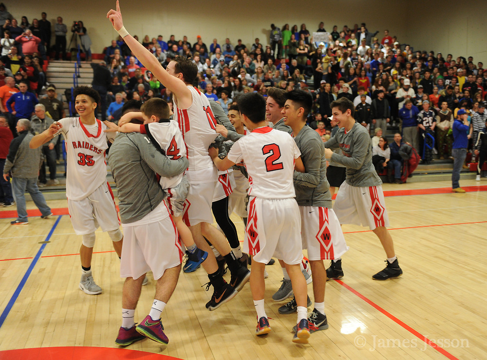 Watertown High School players celebrate after winning the MIAA Division 3 North Sectional Final, beating Bedford High School 59-52, at Burlington High School, March 11, 2017.   [Wicked Local Photo/James Jesson]