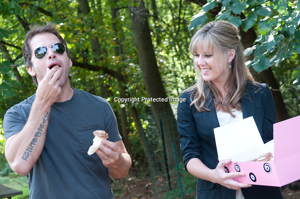 "Director Zach Snyder takes a taste of a cupcake from Adrienne Terry from ""Georgeotwn Cupcake""during a visit to promote the new Warner Brothers' movie ""Legend of the Guardians: The Owls of Ga'Hoole,"" at the Audubon Naturalist Society Wildlife Sanctury in Chevy Chase, Md on September 14, 2010. Photo by Kris Connor"