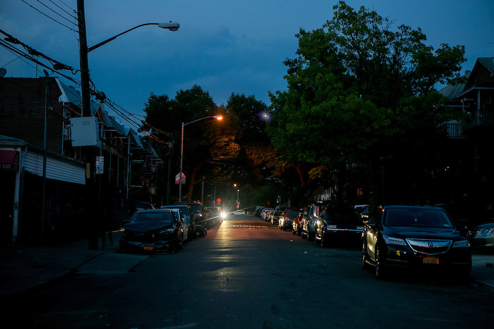 NEW YORK, NY - JULY 7, 2016: A view of a street lit with older streetlights. Other nearby streets have been updated with new LED streetlights in Queens, New York. CREDIT: Sam Hodgson for The New York Times.