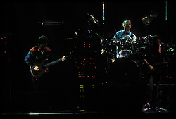 The Grateful Dead perfoming Just Like Tom Thumb's Blues at the Nassau Coliseum, Uniondale NY, 30 March 1990. Phil Lesh, Bill Kreutzmann and Bob Weir.