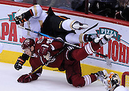 Mar. 2, 2013; Glendale, AZ, USA; Phoenix Coyotes center Lauri Korpikoski (28) collides with the Anaheim Ducks forward Bobby Ryan (9) in the third period at Jobing.com Arena. The Coyotes defeated the Ducks in a shootout 5-4. Mandatory Credit: Jennifer Stewart-USA TODAY Sports