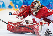 Charline Labonte turns aside a shot as Canada takes on the USA in women's hockey action on February 12, 2014 at the Shayba Arena during the XXII Olympic Winter Games in Sochi, Russia.