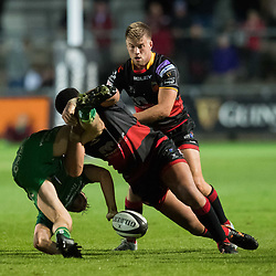 Connacht's Thomas Farrell is tackled by Dragons' Leon Brown<br /> <br />  - Mandatory by-line: Craig Thomas/JMP - 15/09/2017 - RUGBY - Rodney Parade - Newport, Gwent, Wales - Newport Gwent Dragons v Connacht Rugby - Guinness Pro 14