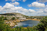Burren National Park, on the back the Mullagh More spectacular hill. Geological evolution over millions of years has arranged this landscape in such a way that today it is now an area of outstanding natural beauty and it is recognised as one of the most distinctive landscapes in Europe