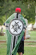 A KKK sympathiser wlaks through the Confederate Cemetery adjacent to Dallas' City Hall before the Anti Racism Rally on Saturday August 19, 2017. A handful of Confederate sympathizers were vastly outnumbered by anti-white supremacy counter protesters.