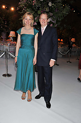 The EARL & COUNTESS OF DERBY at a dinner hosted by Cartier following the following the opening of the Chelsea Flower Show 2012 held at Battersea Power Station, London on 21st May 2012.