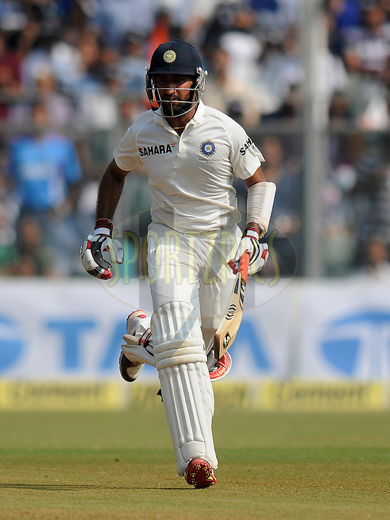 Cheteshwar Pujara of India runs between the wickets during day two of the second Star Sports test match between India and The West Indies held at The Wankhede Stadium in Mumbai, India on the 15th November 2013<br /> <br /> This test match is the 200th test match for Sachin Tendulkar and his last for India.  After a career spanning more than 24yrs Sachin is retiring from cricket and this test match is his last appearance on the field of play.<br /> <br /> <br /> Photo by: Pal PIllai - BCCI - SPORTZPICS<br /> <br /> Use of this image is subject to the terms and conditions as outlined by the BCCI. These terms can be found by following this link:<br /> <br /> http://sportzpics.photoshelter.com/gallery/BCCI-Image-Terms/G0000ahUVIIEBQ84/C0000whs75.ajndY
