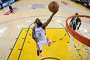 April 30, 2019; Oakland, CA, USA; Houston Rockets guard James Harden (13) shoots the basketball against Golden State Warriors guard Klay Thompson (11) during the second half in game two of the second round of the 2019 NBA Playoffs at Oracle Arena. The Warriors defeated the Rockets 115-109.