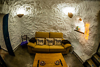 Interior view of a living room,  Balcones de Piedad, Los Balcones, near Guadix, Granada Province, Andalusia, Spain. Five cave apartments in this boutique hotel give visitors the opportunity to stay in a luxury suite built into a cave.