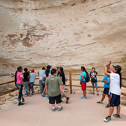 061213       Brian Leddy<br /> Chinle area students look over the inscriptions at El Morro National Monument Wednesday. The group of over 30 students spent the day learning the history of the area.